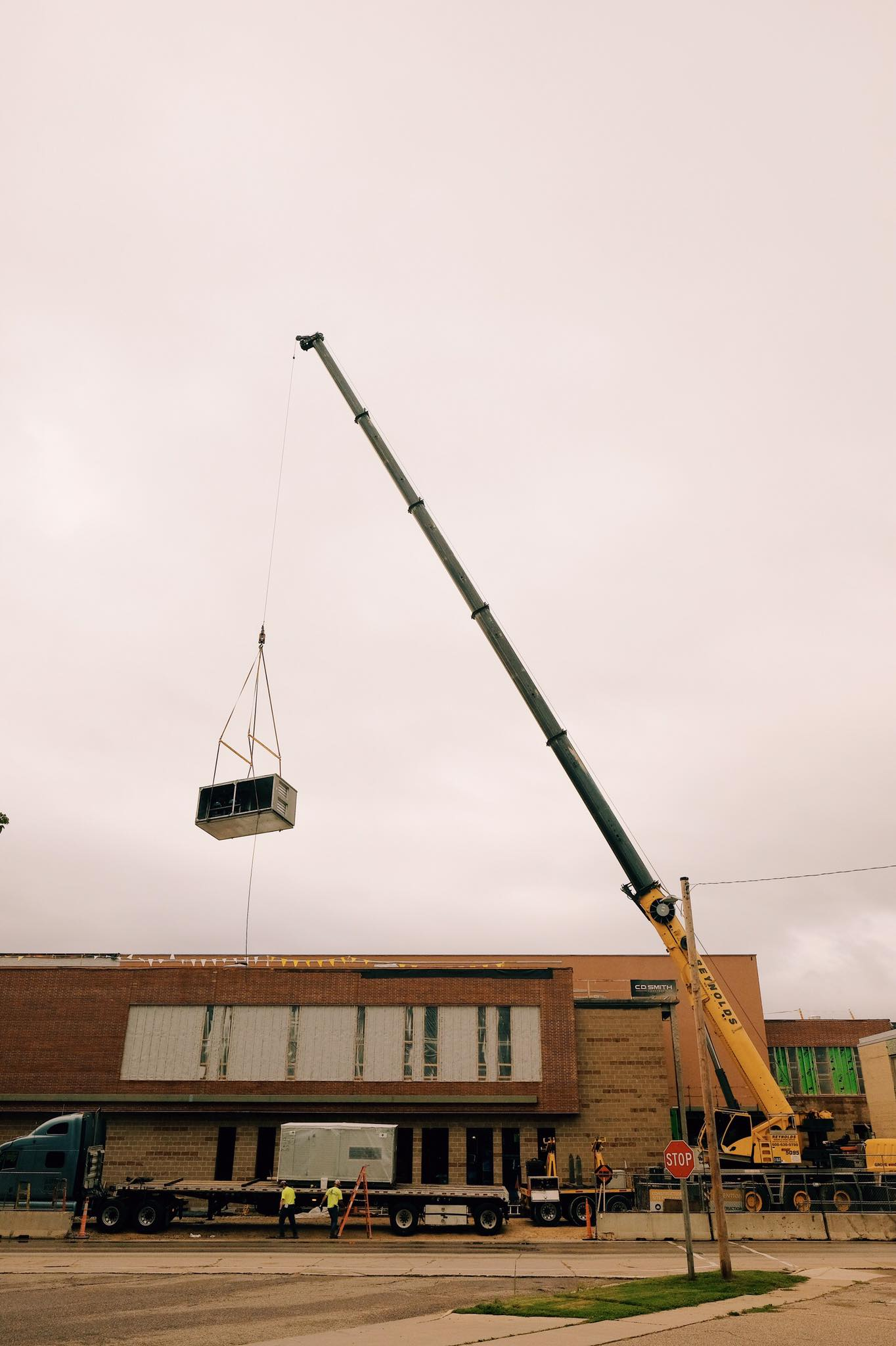 Air handlers lifted to the rooftop.