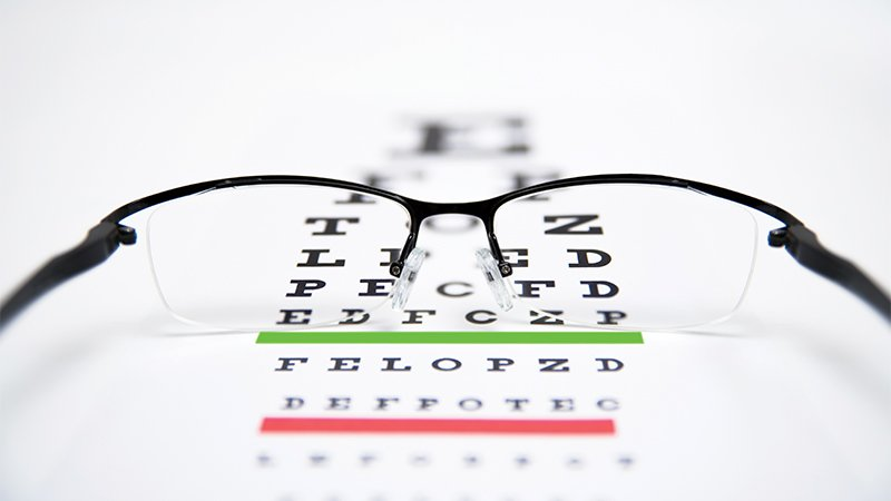 a pair of glasses on a vision test