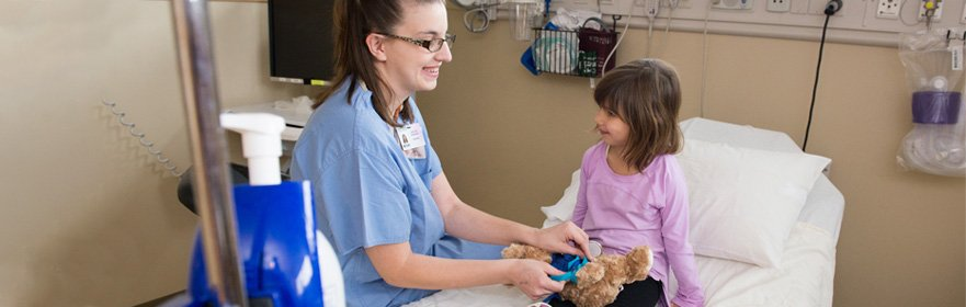 child life specialist with pediatric patient