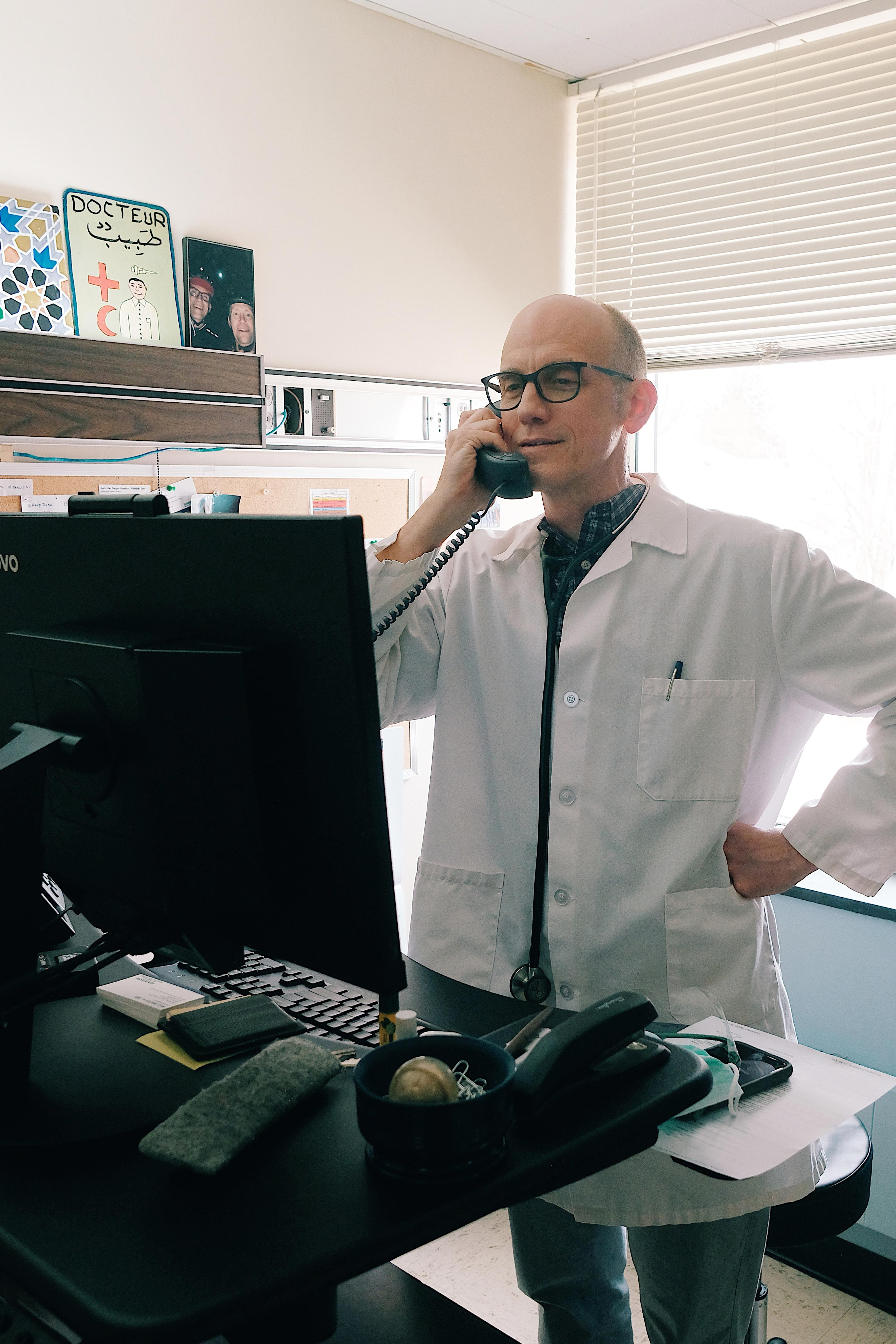 Doctor doing a phone visit