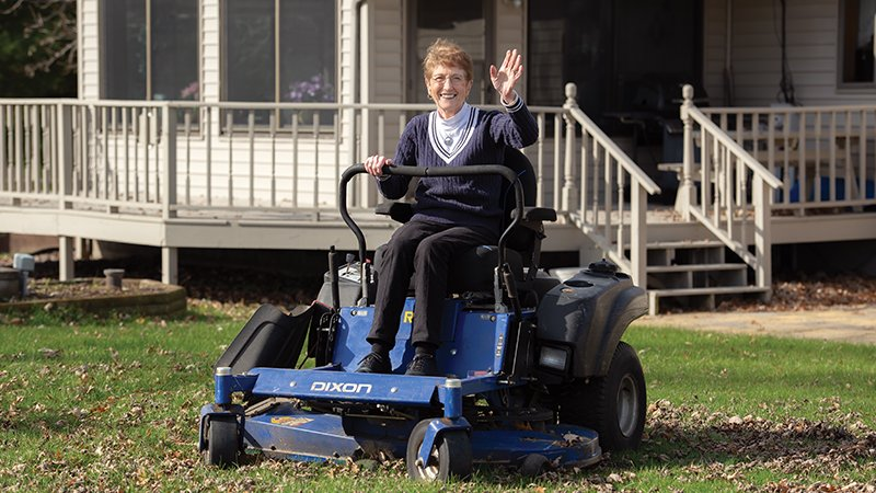 Betty Halama on her lawnmower