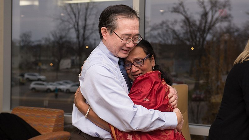 Dr. Kwong and Mrs. Ahmed hugging