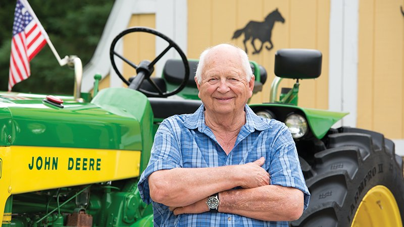 Charlie Larson in front of a tractor