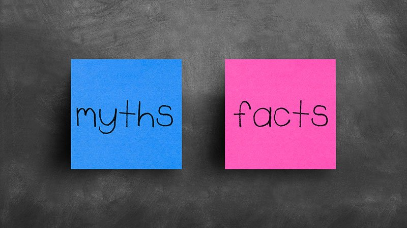 sticky notes on a blackboard - myths and facts