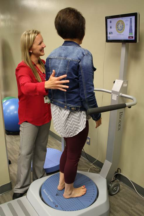 Rehab Services Director Robyn Moritz demonstrates the Biodex Balance System