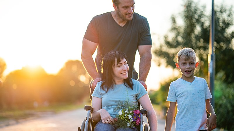 husband pushing wife in wheelchair
