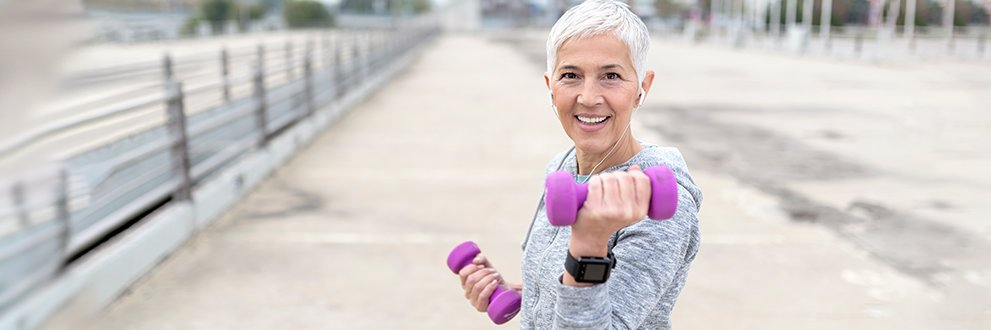 older woman with dumbbells