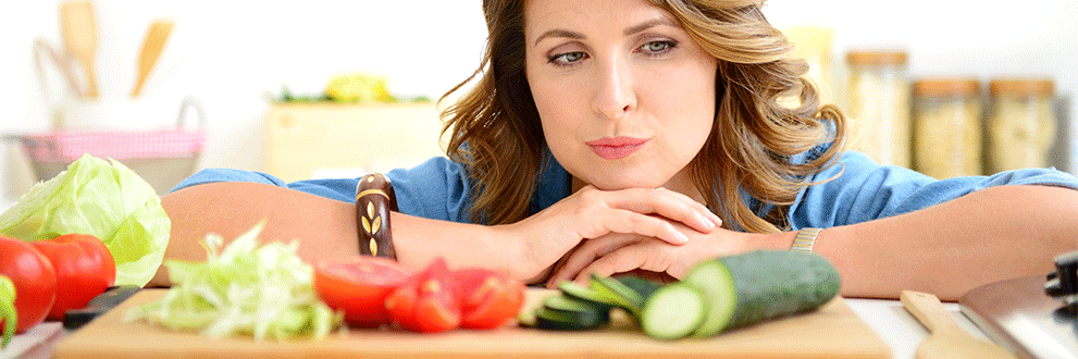 woman deciding to eat vegetables-coming out of your food comfort zone
