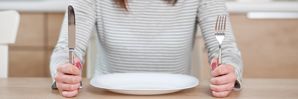 What is intermittent fasting-woman with dinner plate