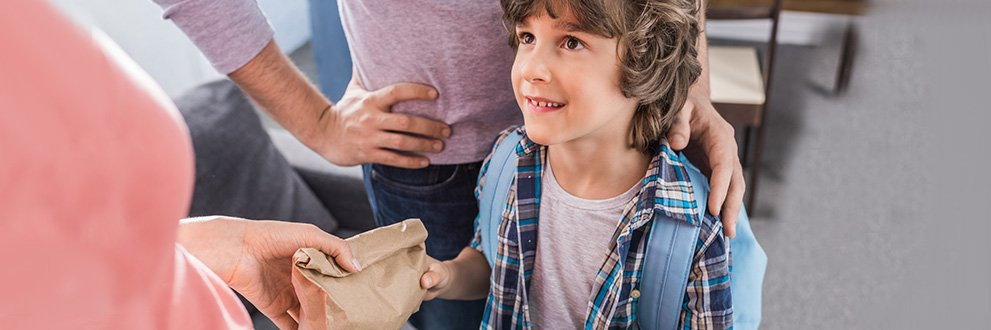 child with lunchbag