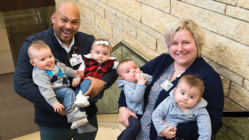 Gundersen Tomah Clinic obstetrican and gynecologist Robert Holness, MD, and pediatrician Kelly Hodgson Kline, MD, hold the twins who were born a week apart in Tomah in 2019