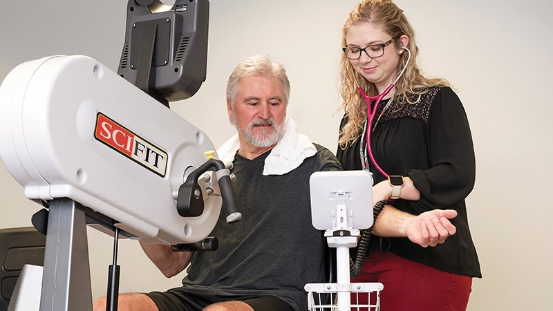 Reginald Hudson and Hannah Crary, exercise physiologist, work together to rebuild his strength after quadruple bypass surgery.