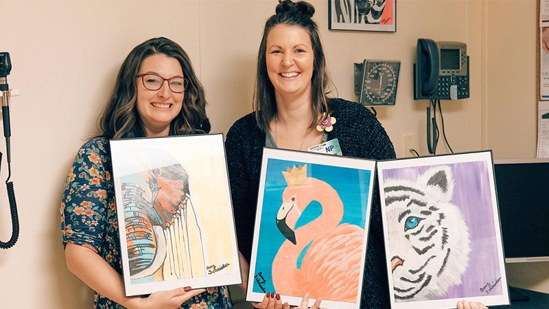 Artist Amy Schneider with provider Jessica Thompson, NP - Elroy Clinic